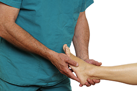 podiatrist with patient examining foot pain